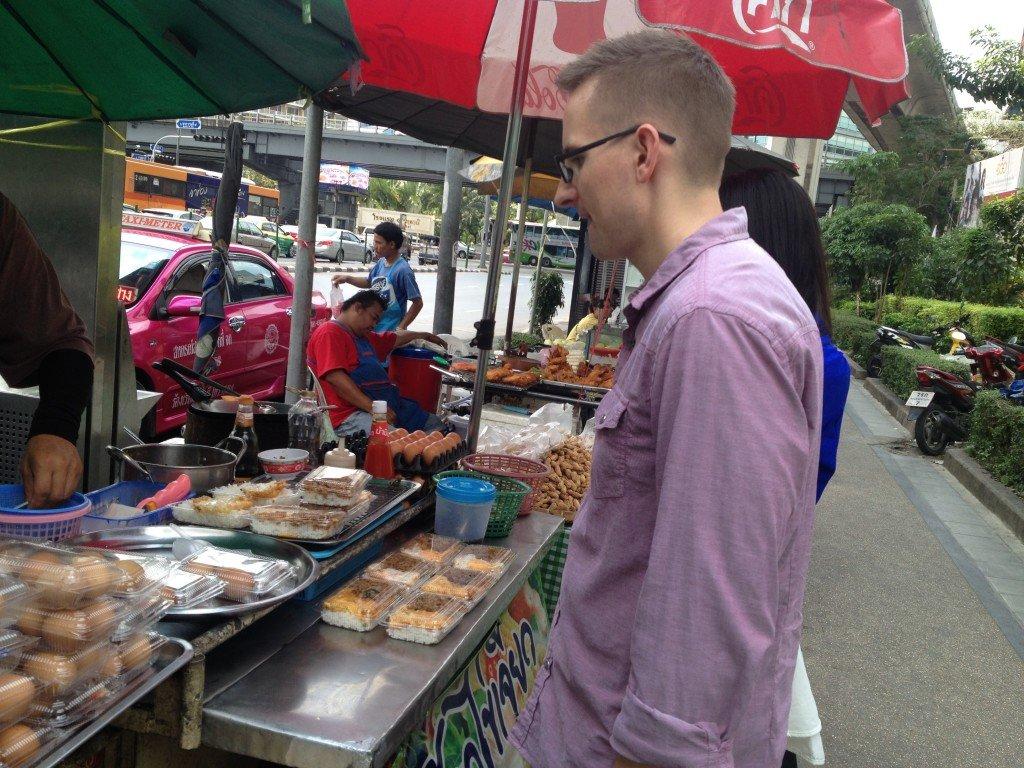 Getting food at a street market in Bangkok.